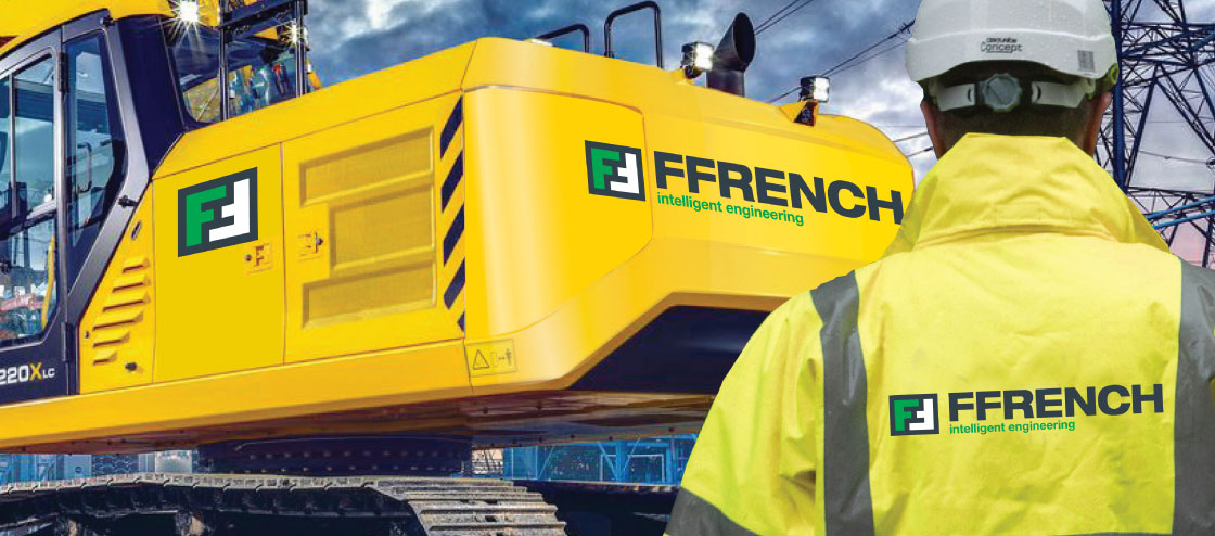 Ffrench manager in front of large caterpillar construction vehicle