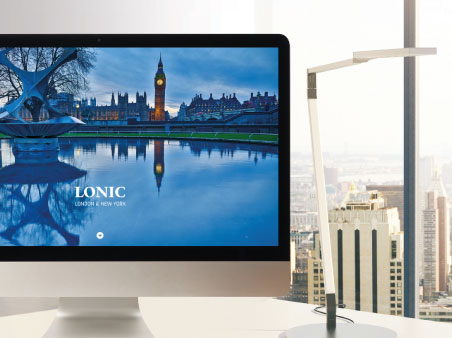 Lonic commercial property website on large PC screen in an office