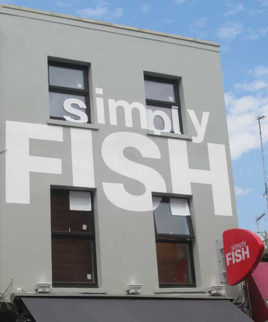 Simply Fish restaurant exterior - front on view of branding