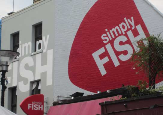 Simply Fish restaurant exterior - side on view of branding